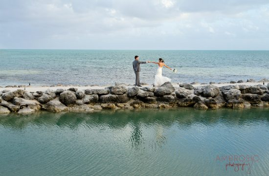 A bride and groom dance on the rocks at the Cheeca Lodge in Key Largo.
