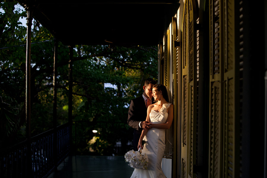 A couple pose for portraits at the Hemingway House in Key West during sunset.