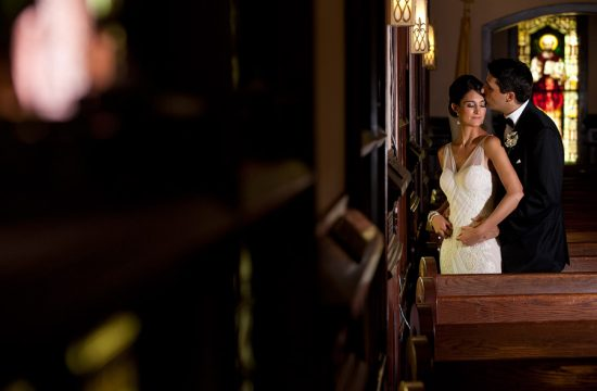 An indoor wedding portrait at St Ann's church in Palm Beach.
