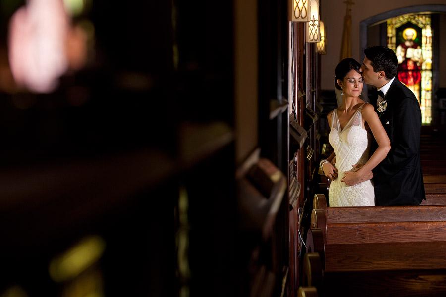 An indoor wedding portrait at St Ann's church in Palm Beach.
