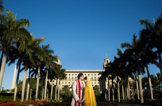 An indian wedding couple pose for a portrait at the Breakers in Palm Beach.
