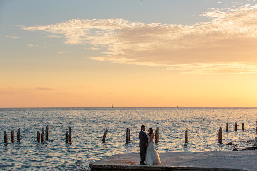 A couple stand on a dock at the Southernmost Hotel in Key West during their wedding day.