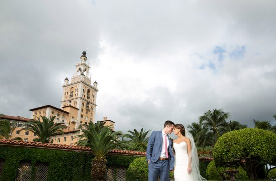 Bride and groom laughing at the Biltmore Hotel in Coral Gables.