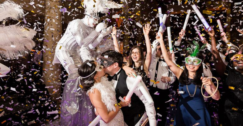 Bride and groom as confetti falls during their wedding at the Biltmore Hotel.