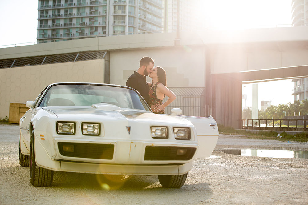 Downtown miami engagement session with a vintage car.