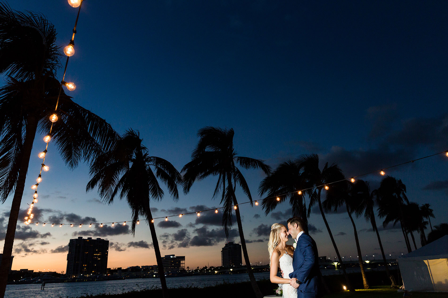 Bride and groom at sunset at the Flagler Museum.