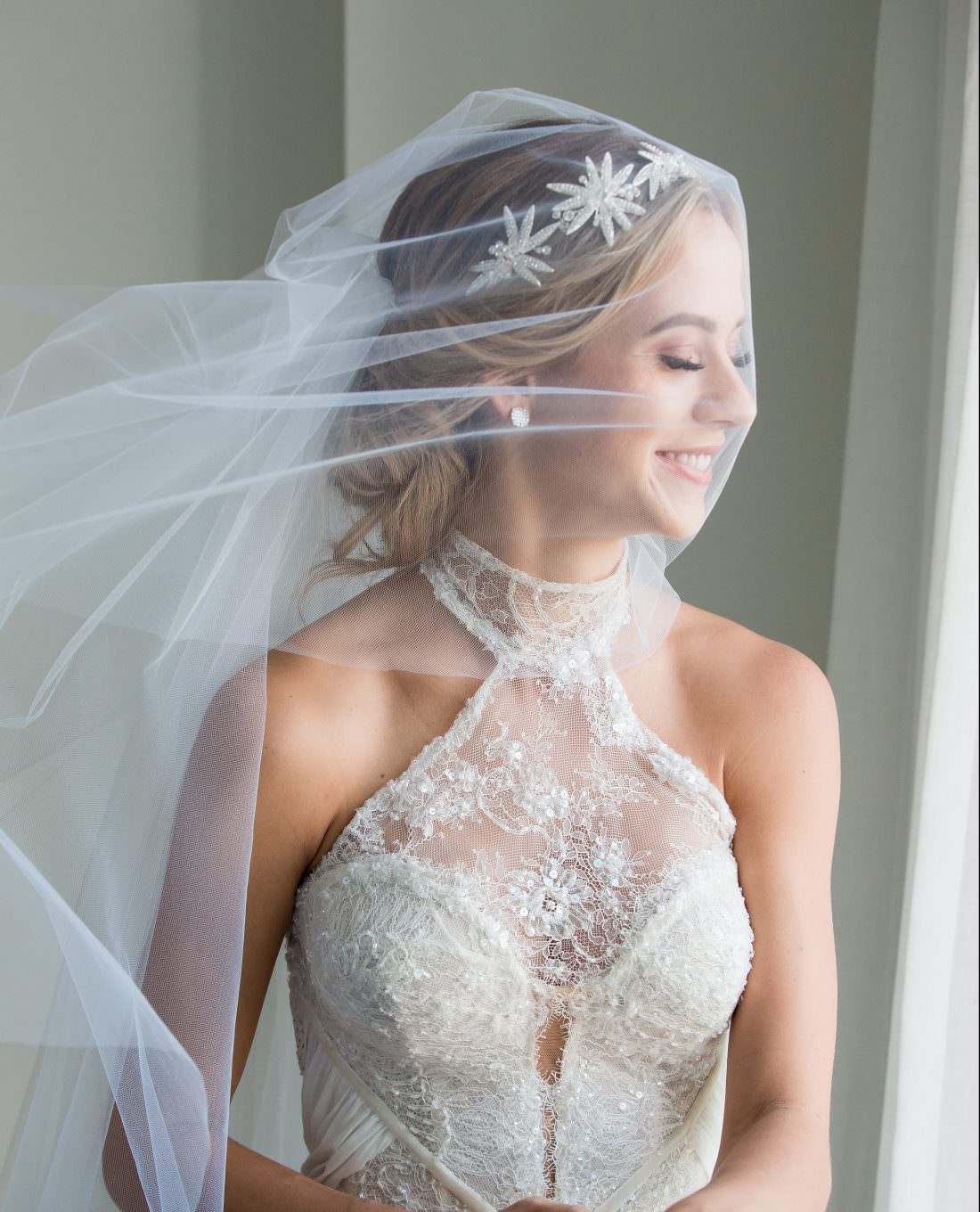 Veil blowing in the wind during a wedding at the SLS in Baha Mar in the Bahamas.