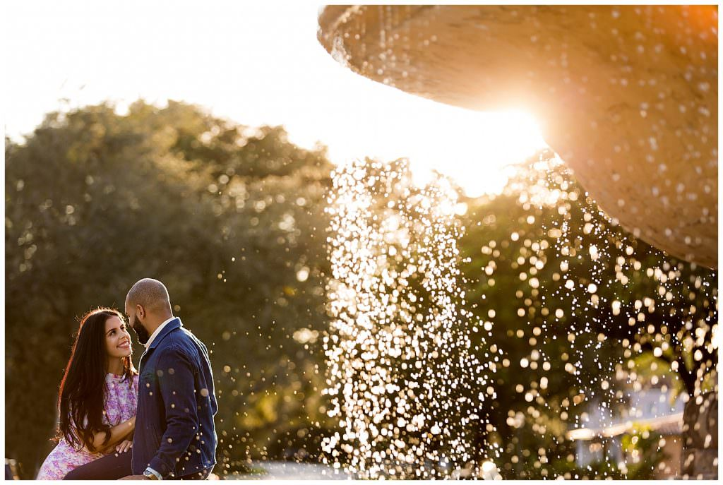 Bride and groom at De Soto Fountain during their engagement session in Coral Gables.