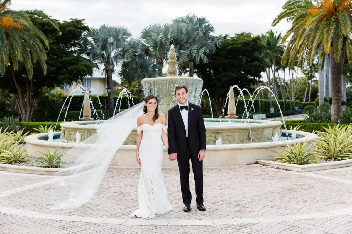 Bride and groom in front of the fountain at the Ritz Carlton in Key Biscayne.