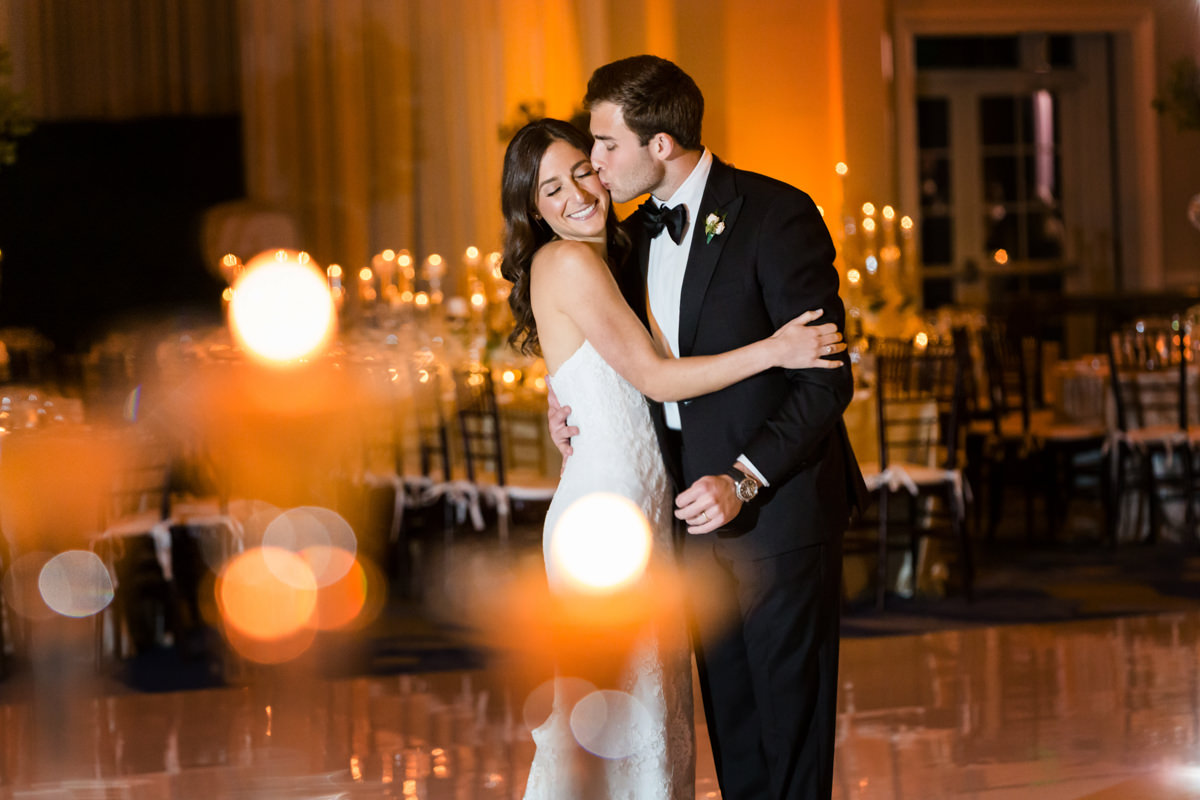 Bride and groom kissing in the ballroom n at the Ritz Carlton in Key Biscayne.