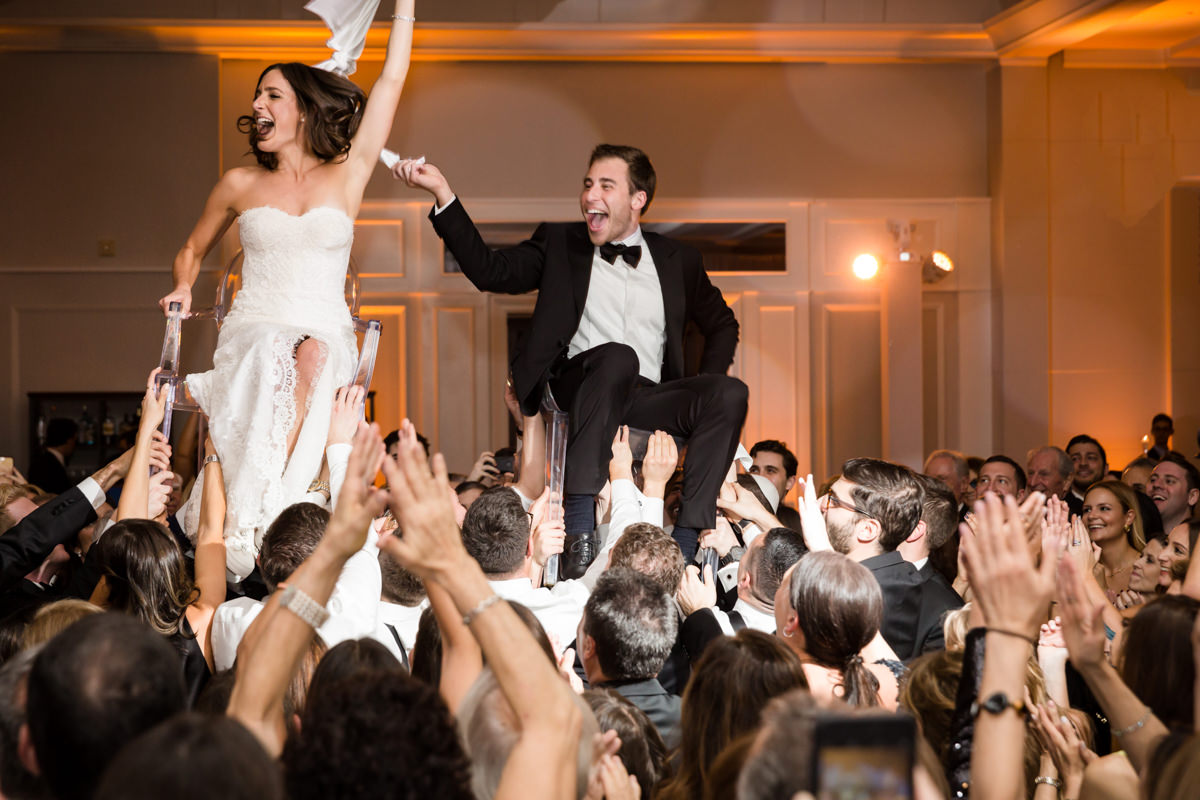 Couple doing the hora during their wedding at the Ritz Carlton in Key Biscayne.