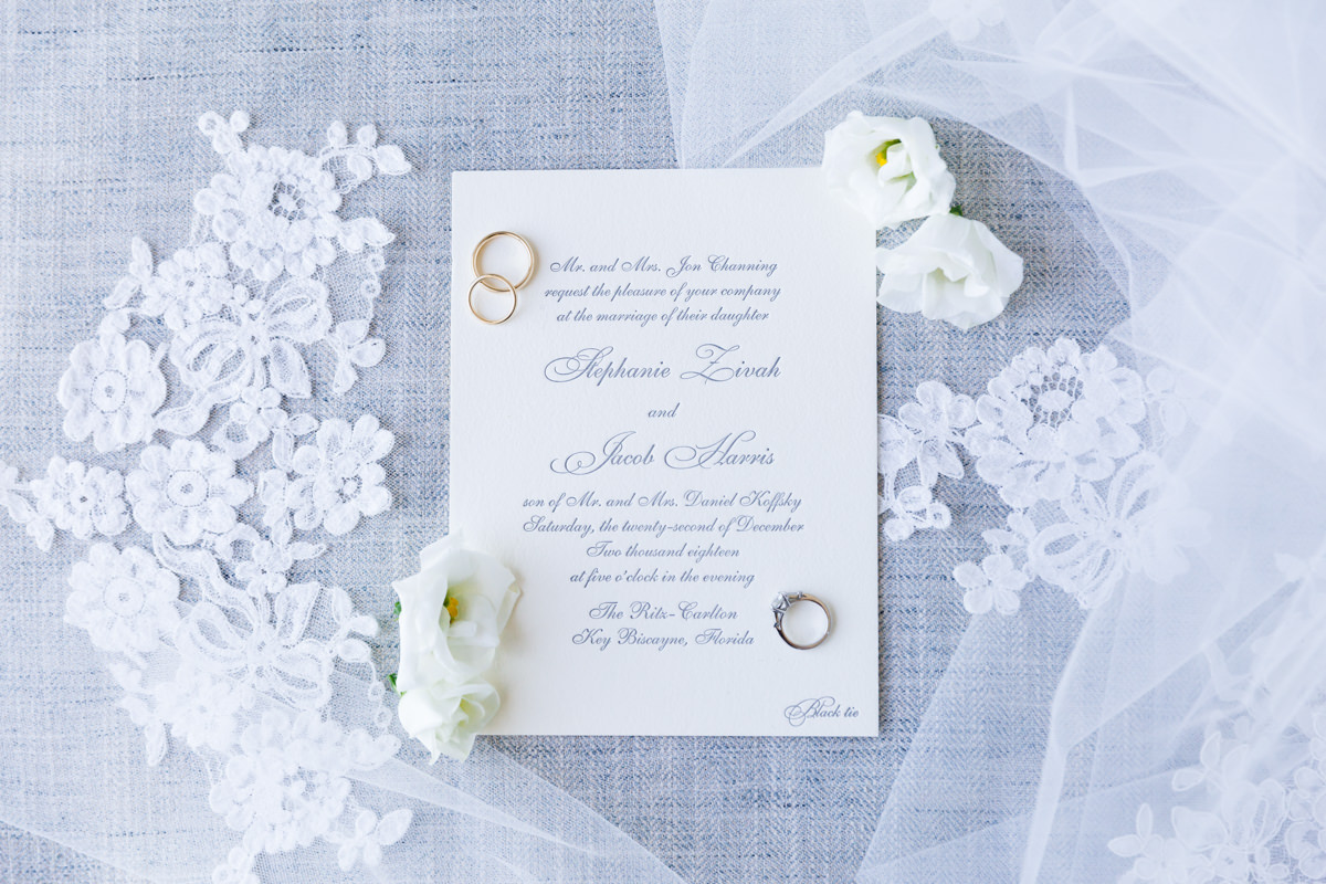 Wedding rings on a letterpress invitation at the Ritz Carlton on Key Biscayne.