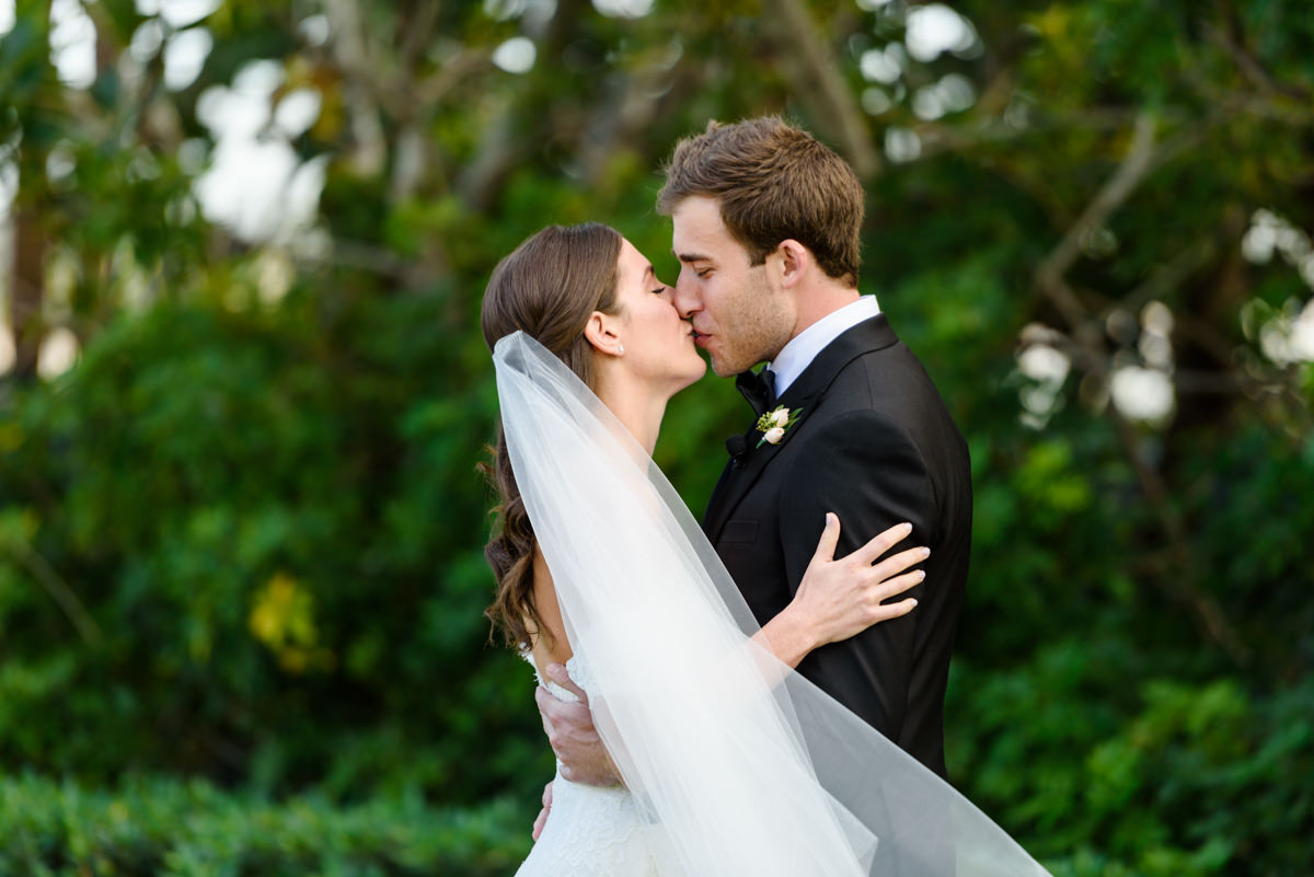 Bride and groom kissing at their wedding at the Ritz Carlton in Key Biscayne.
