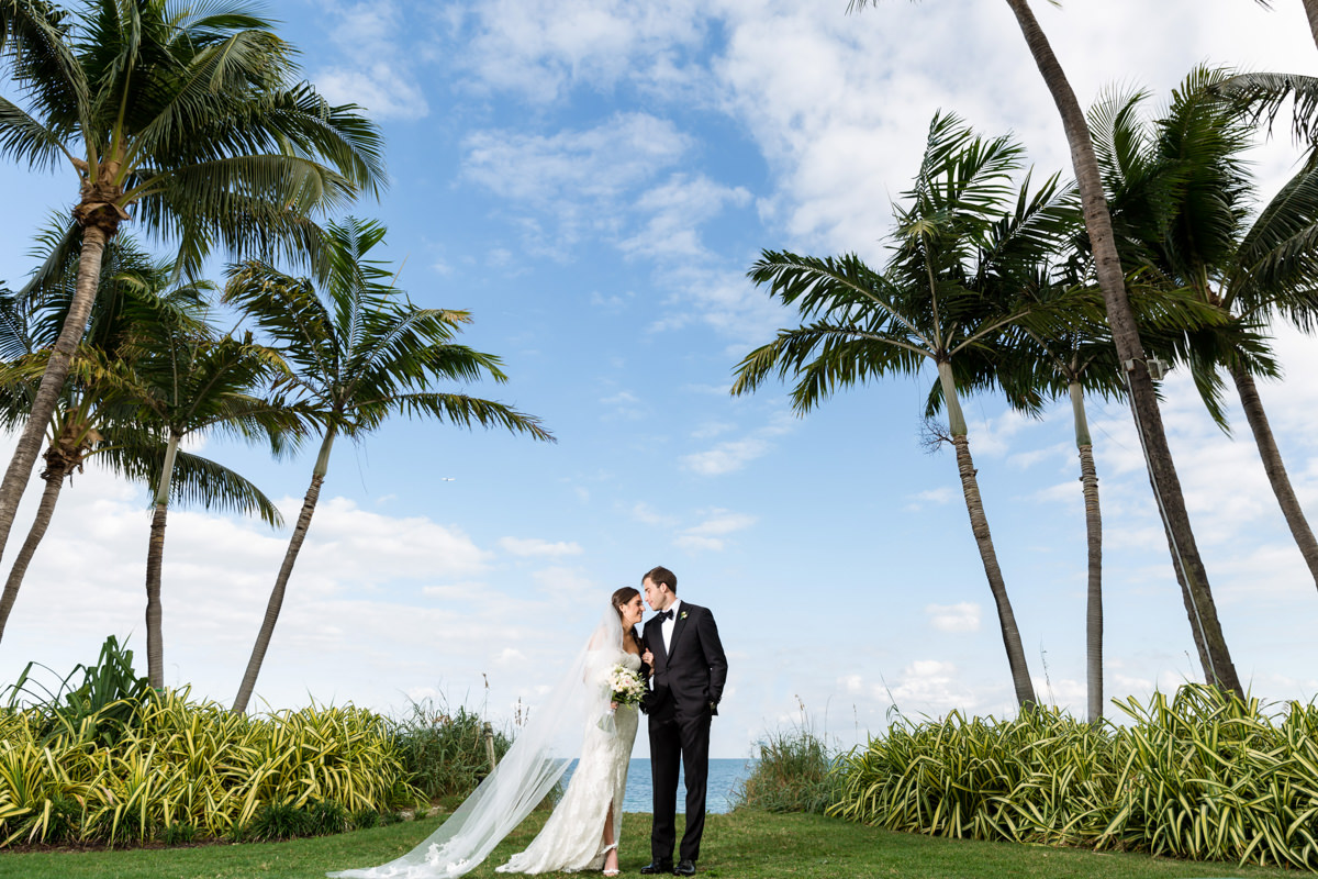 Bride and groom laughing during a wedding at the Ritz Carlton in Key Biscayne.