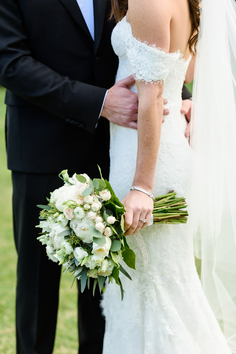 A white bridal bouquet against a lace dress at the Ritz Carlton on Key Biscayne.