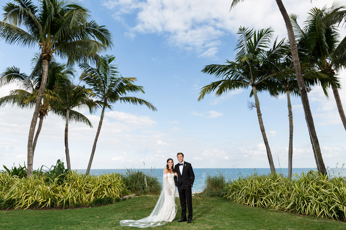 A couple posing by the ocean at the Ritz Carlton in Key Biscayne.
