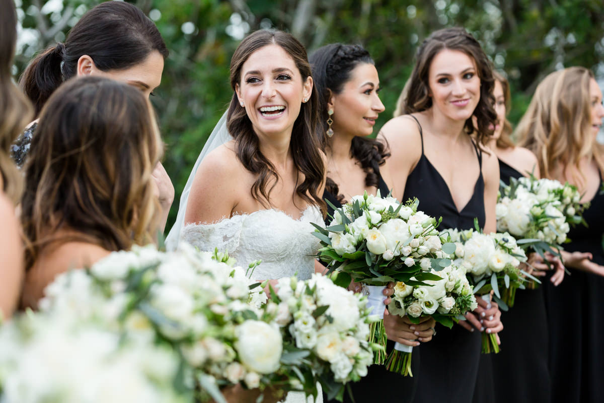 Bride laughing with her bridesmaids at the Ritz Carlton in Key Biscayne.