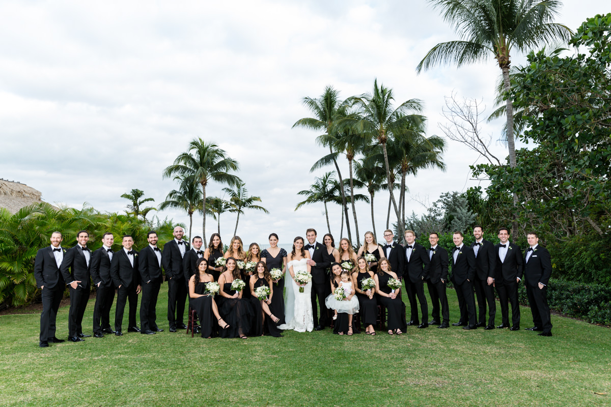 Large bridal party dressed in all black at the Ritz Carlton in Key Biscayne.