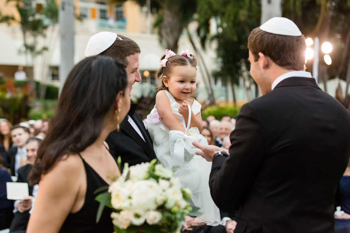 Flower girl passing out flowers at the Ritz Carlton in Key Biscayne.