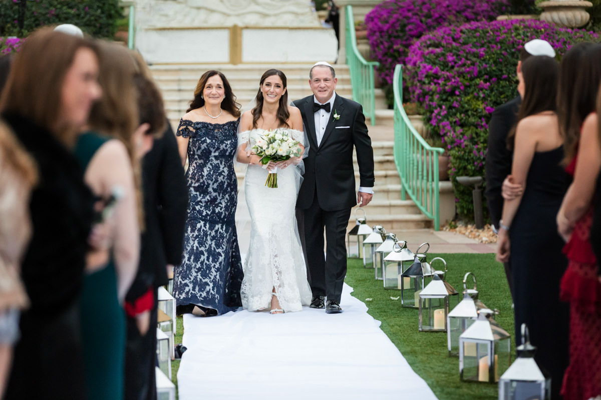 Bride escorted by her parents at the Ritz Carlton in Key Biscayne.
