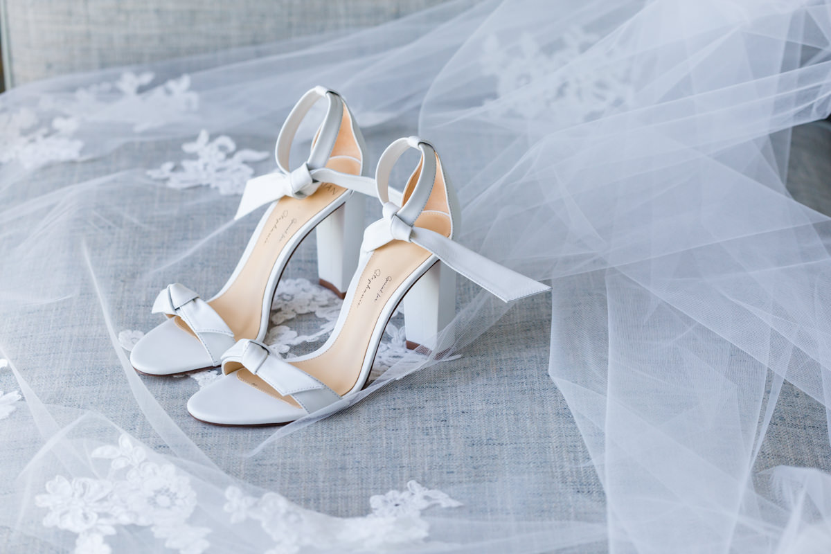 Detail of wedding shoes and veil during a wedding at the Ritz Carlton in Key Biscayne.
