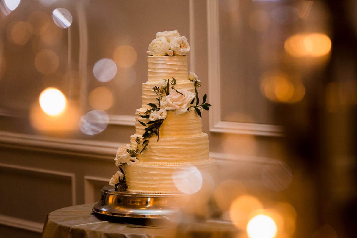 A white wedding cake adorned with flowers at the Ritz Carlton on Key Biscayne.
