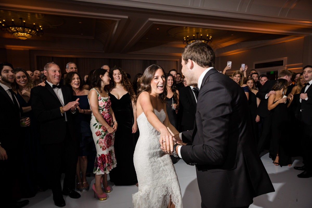 Bride and groom make an entrance into their wedding reception at the Ritz Carlton on Key Biscayne.