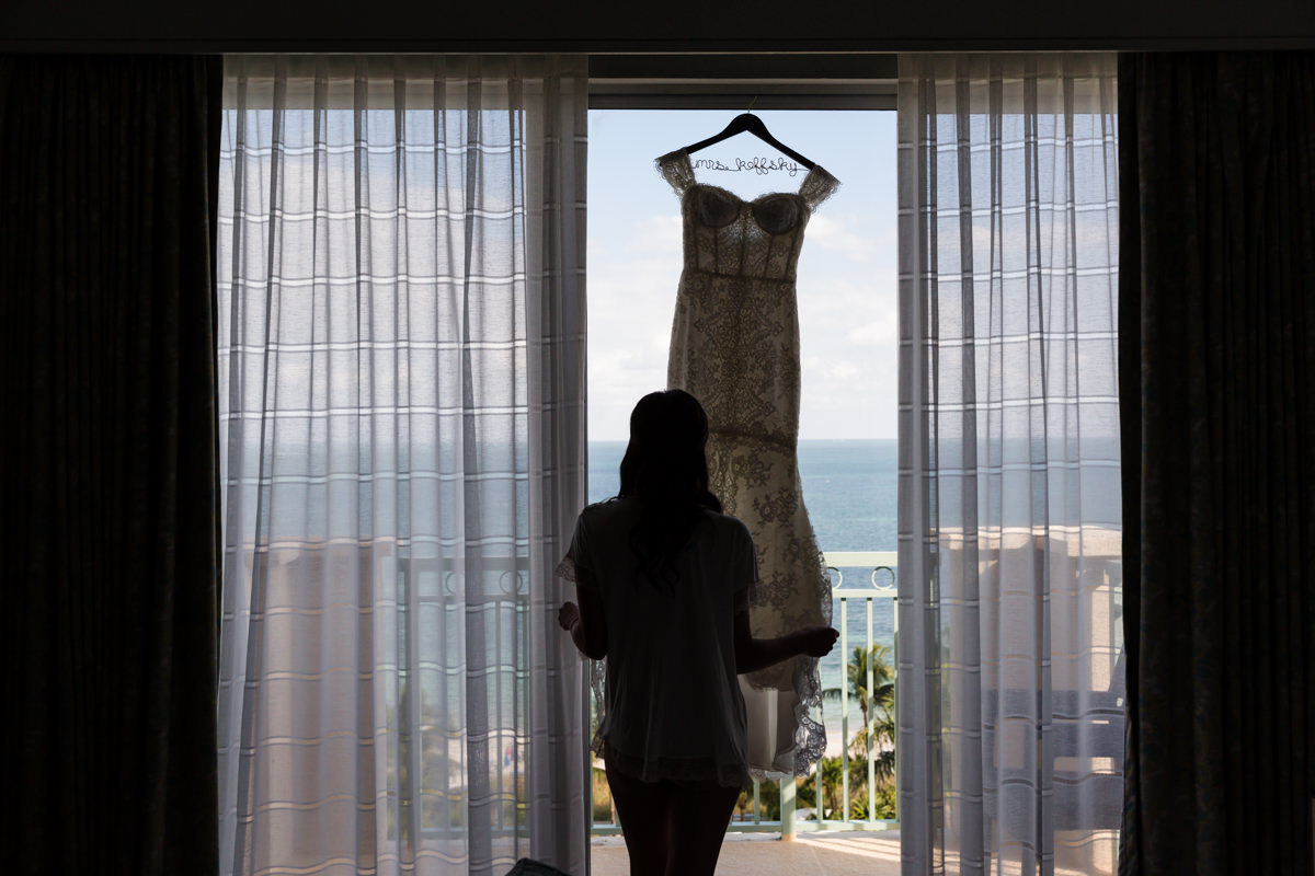 Bride and her wedding gown in a window at the Ritz Carlton in Key Biscayne.