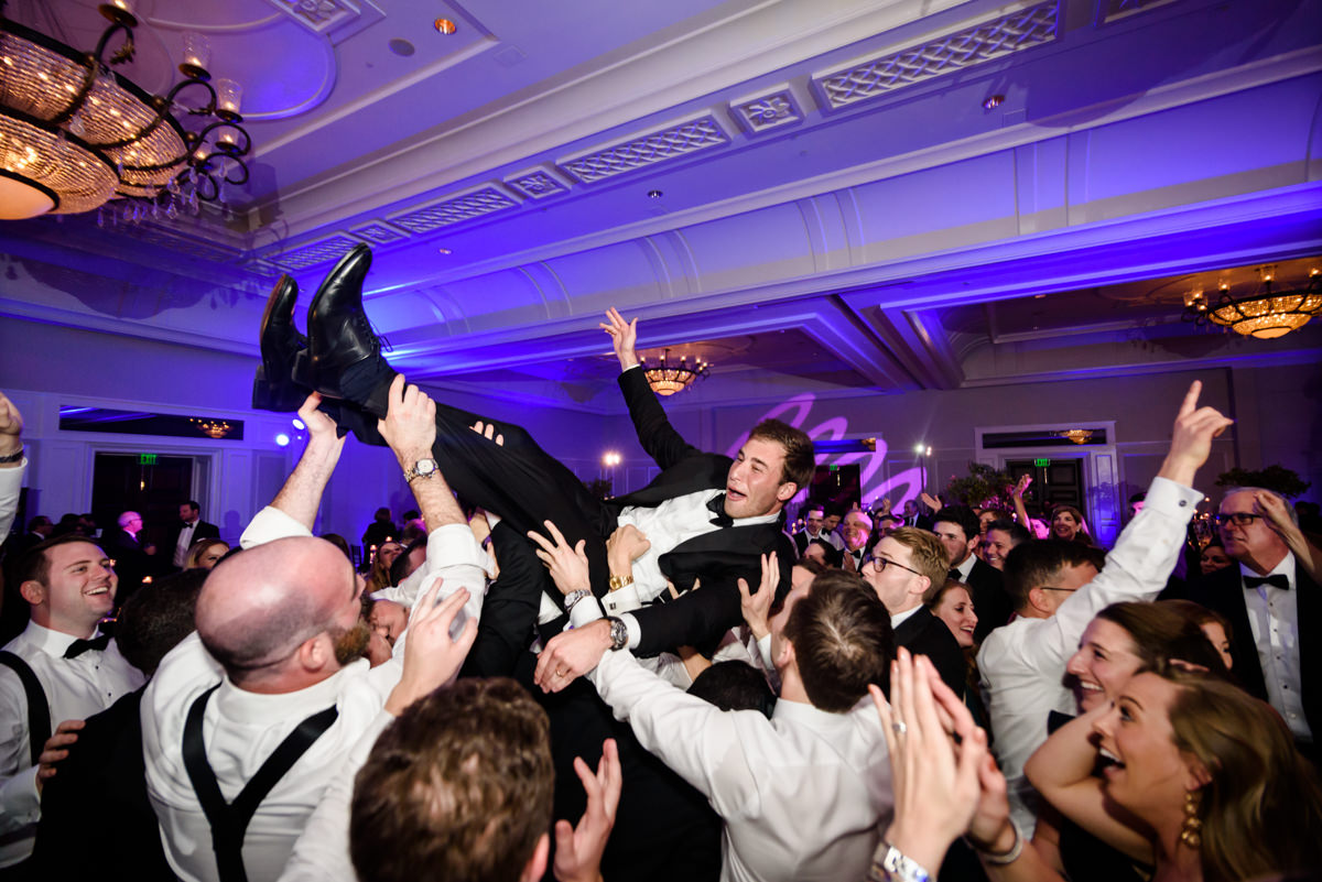 Groom crowd surfs in the ballroom at the Ritz Carlton in Key Biscayne.