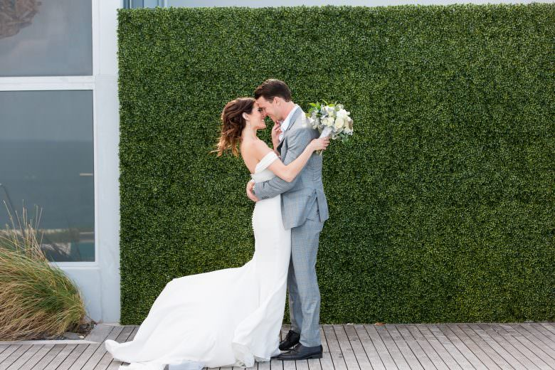 Bride and groom kiss during their first look at the Hilton on Miami Beach.