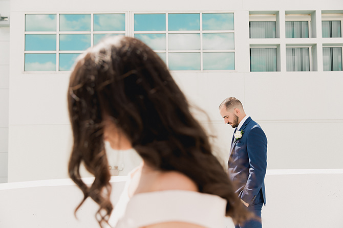 Groom waiting for his bride on the roof of the Miami Beach Courthouse.