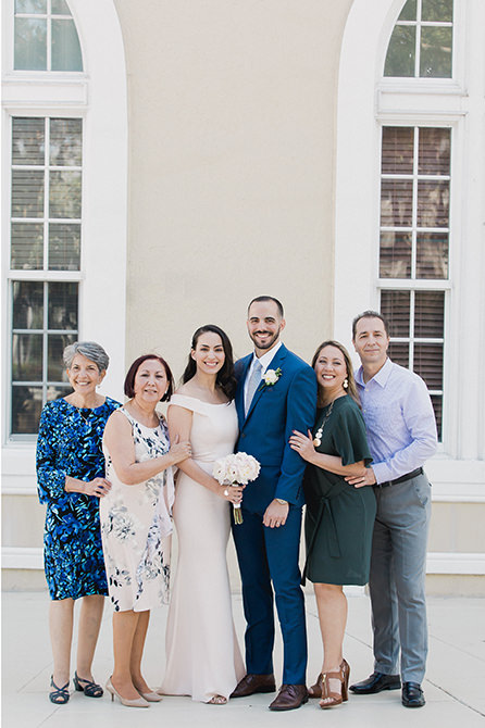 A family poses for a portrait outside Miami Beach city hall after their elopement.