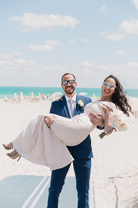 Couple kissing on the beach after their elopement at Miami Beach city hall.