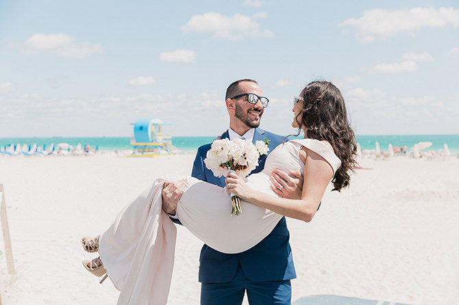 Couple smiling on Miami Beach after their elopement at city hall.